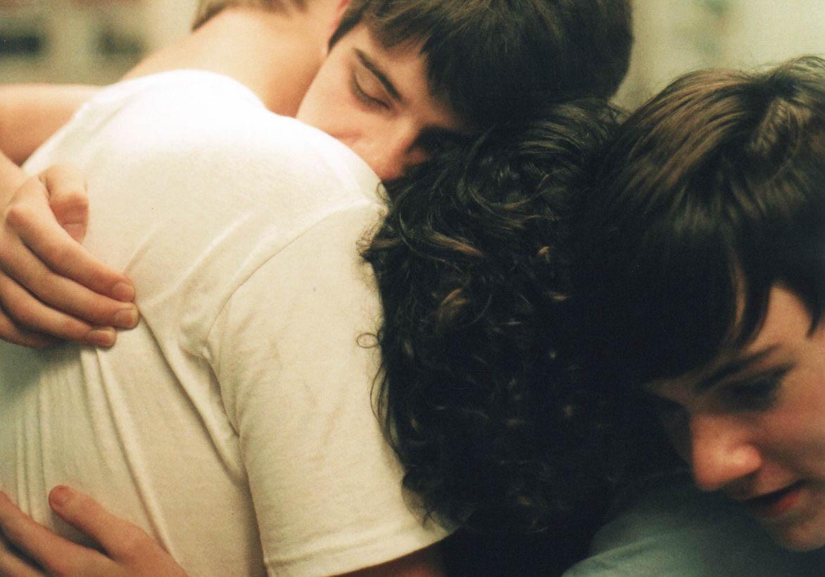 Teens hugging