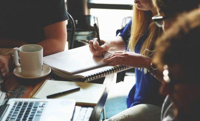 Teens with journals