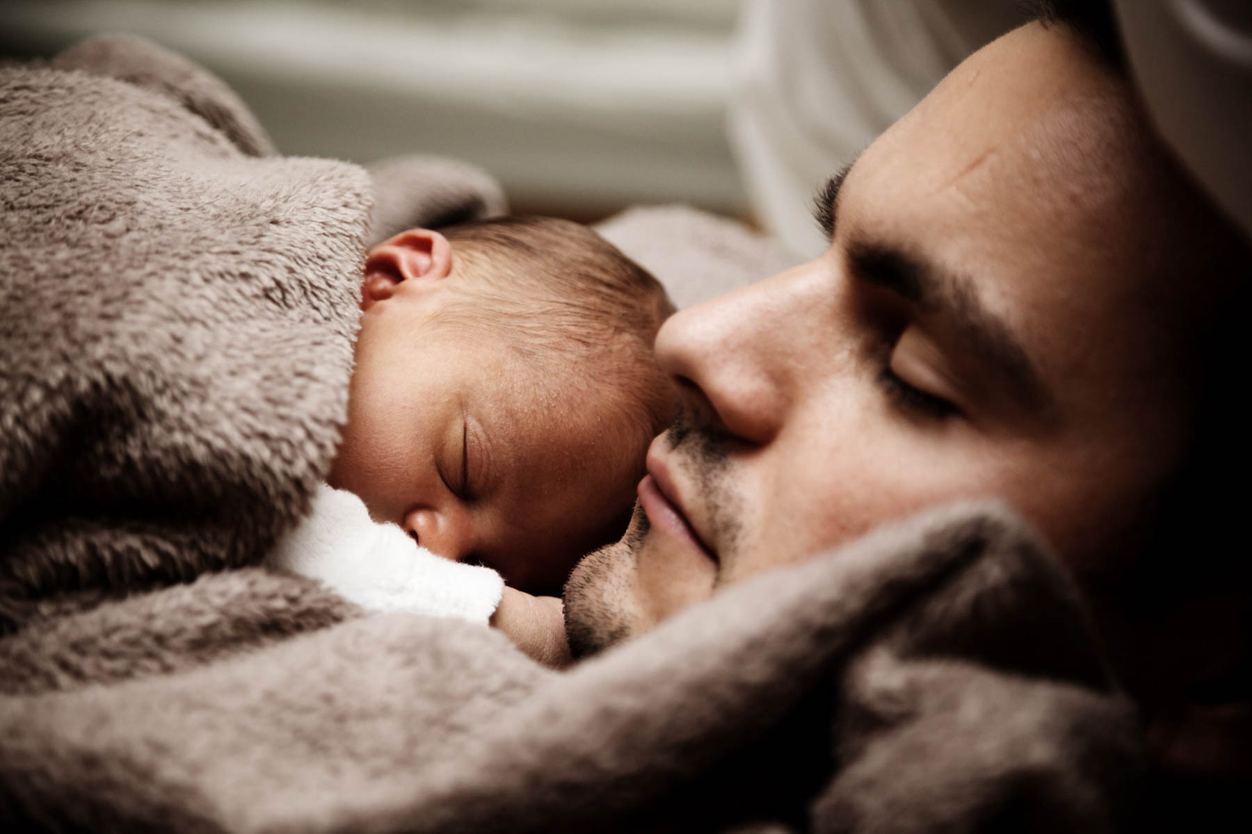 Dad with sleeping baby